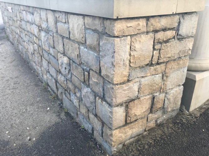 Boundary wall completed using machined Blue Centre Sandstone