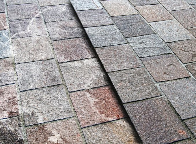 Natural stone paving stained with Efflorescence