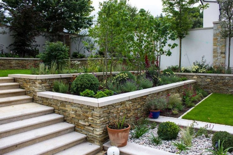 Gold Granite Wall Capping - Photo Credit: Tully Landscapes
