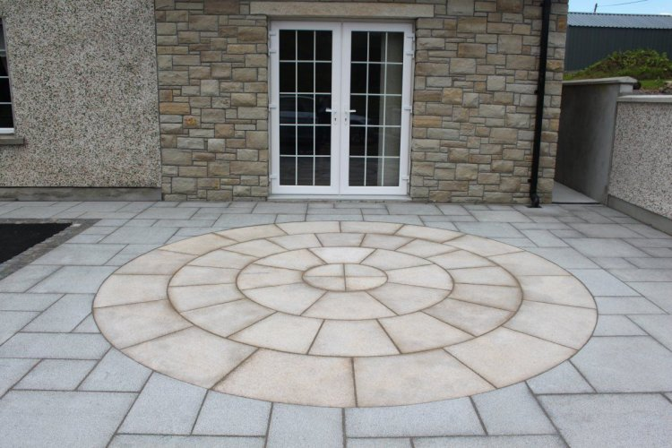 Patio completed using our Gold Granite Circle and Silver Granite Paving.