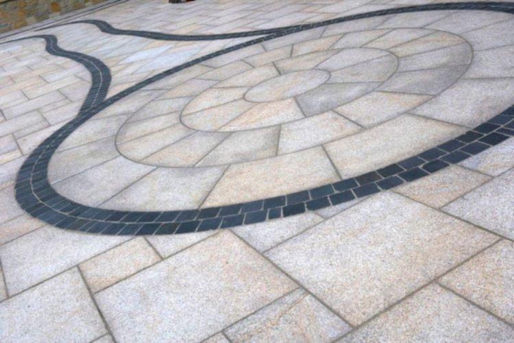 Gold Granite Circle and Paving with Black Limestone Sett  100 x 100 pathway border.