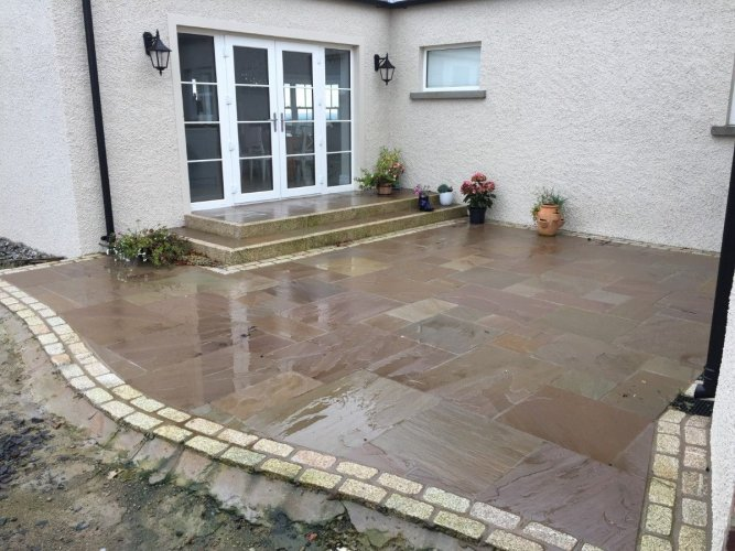 Patio border completed using Gold Granite Cobbles 200 x 100. Image by Dornan's Paving