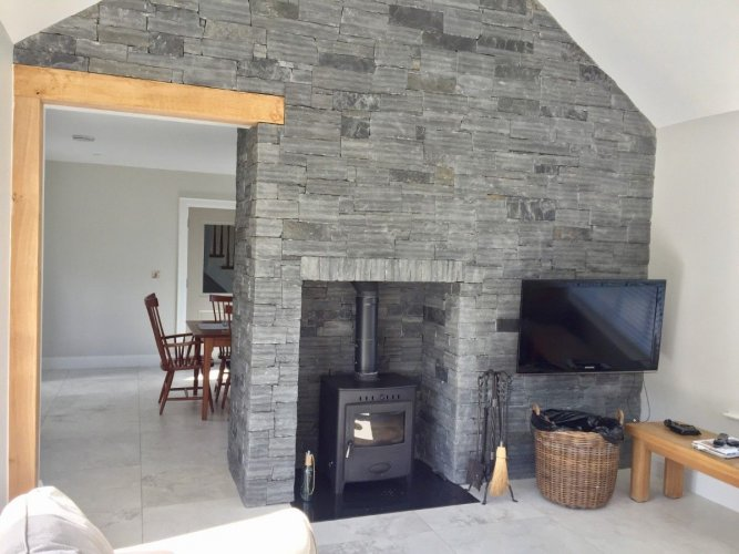 Liscannor Slate fireplace & feature wall built using stoneer cladding