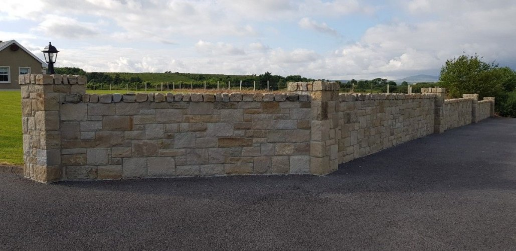 Boundary wall completed using mountcharles sandstone stoneer cladding