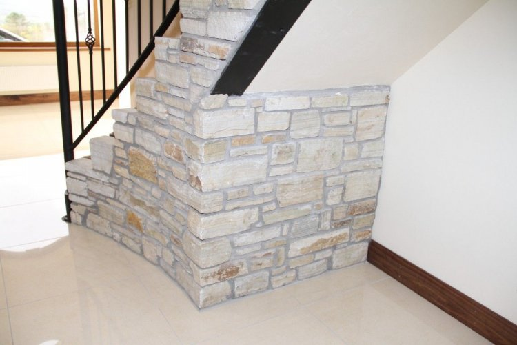 Natural stone walling on internal staircase - Silver Donegal Quartzite Machine Block