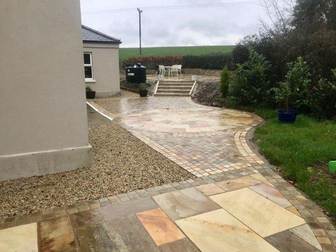 Tinted Mint Sandstone Paving Circle : Credit Dornans Paving And Landscaping