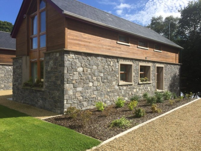 Completed using White Limestone machined walling stone.