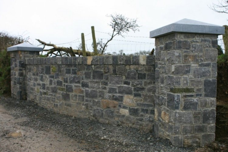 Boundary wall completed using White Limestone machined walling stone.