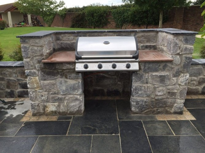 Outdoor BBQ completed using White Limestone machined walling stone.