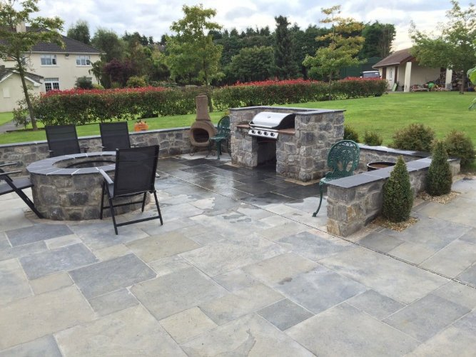 Outdoor BBQ area and fire pit completed using White Limestone machined walling stone.