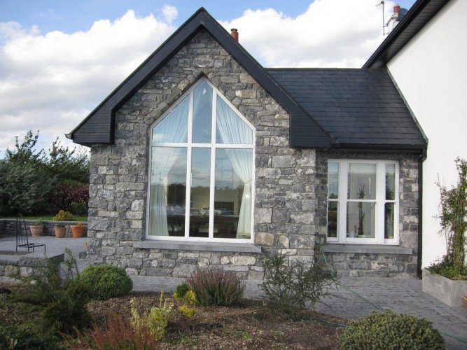Conservatory with white limestone walling stone