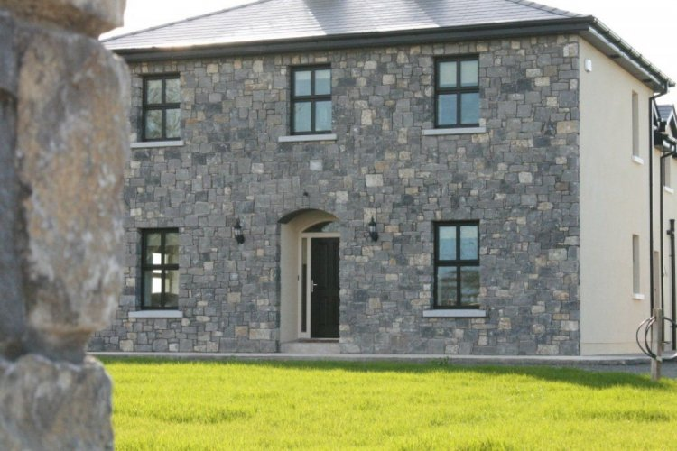 Front facade with White Limestone machined walling stone.
