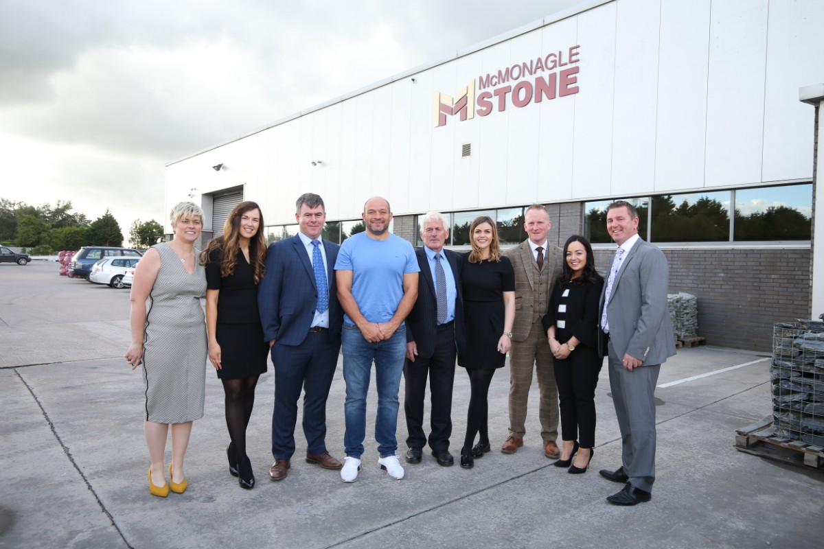 McMonagle Stone Team pictured with Rory Best outside new showroom in Lisburn, Northern Ireland.
